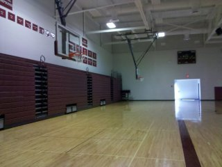 """The new """"competition size"""" gym, which appeared to be about the same size as the original gym, wasconstructed over the old tennis courts. Here is where all of the various athletic swag was now located. I, however, fail to see how a completely new gym was necessary, especially considering that physical education courses are not required beyond the tenth grade level in Virginia."""