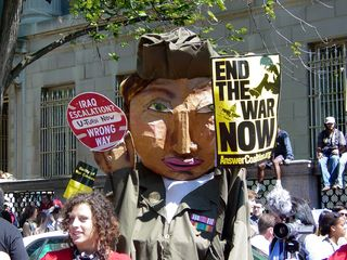 A street puppet, dressed in a military uniform, called for an end to the war.