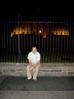 First, Ataan posed alone in front of the White House.
