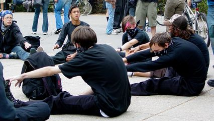 Black bloc participants take a moment to stretch before the march.