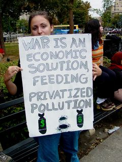 As this was a march against the World Bank and IMF that was feeding into the larger anti-war march downtown, many participants' signs reflected both topics on the two sides of their posters.