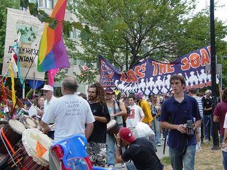 The feeder march demonstrating against the School of the Americas makes a noisy entrance into Dupont Circle.