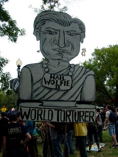 One of the largest signs depicted Paul Wolfowitz, president of the World Bank, as an emperor, and world torturer.