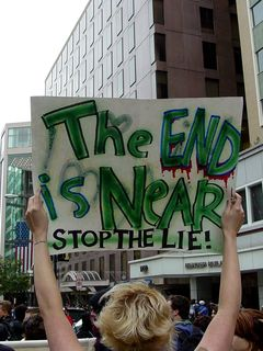 """The serious message on the other side of the sign said, """"The end is near, stop the lie!"""""""