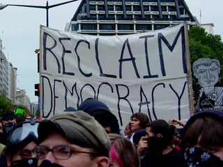"""Perhaps the largest and most noticeable banner was this large, white one, reading """"Reclaim Democracy""""."""