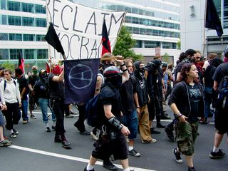 The black bloc, now by itself, attempts to continue on.