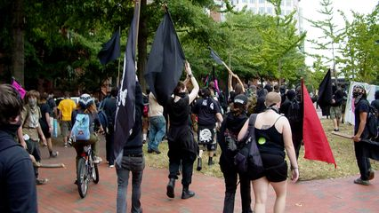 After the brief brush with Park Police, the black bloc heads north and exits Lafayette Square.
