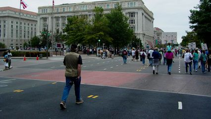 Passing the west side of Freedom Plaza, preparing to make a turn onto Pennsylvania Avenue.