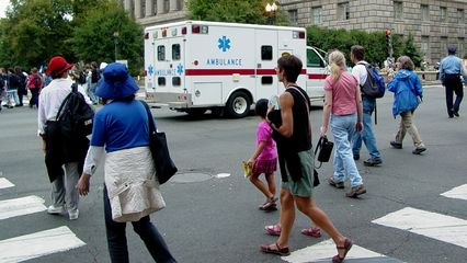 The march parted momentarily to allow an ambulance to continue north on 14th Street NW.