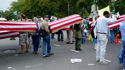 Since the October 2, 2004 march (Day of Activism photography set), cardboard coffins, either black-draped or flag-draped, have been a staple at anti-war demonstrations.
