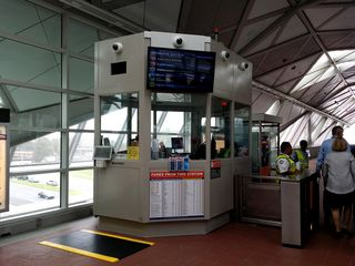 This was the first time that any of us saw the kiosks at the new stations. Yes, those kiosks are white, not dark brown as in the existing stations.