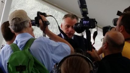 Virginia governor Terry McAuliffe speaks to the media prior to the opening ceremony.