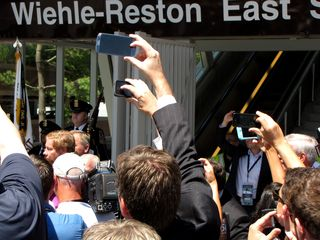 Everyone was photographing the ribbon cutting with their phones.