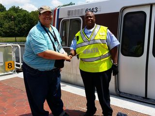 Handshake with Detrick Washington, the operator of the first Silver Line train.
