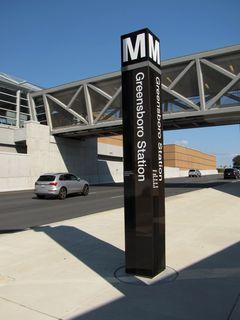 Station entrance pylon at Greensboro.