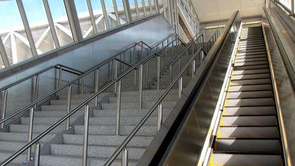 Escalator and stairs to the pedestrian bridge at Greensboro.