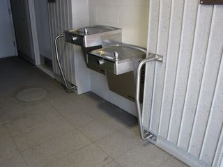 Water fountains adjacent to restrooms in the mezzanine at Greensboro station.