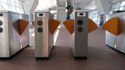 The faregates at Spring Hill. Note that these are steel-colored, rather than brown as in the older stations.