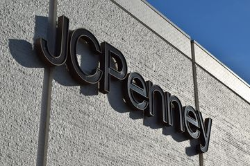 Sign on the former JCPenney store, never removed from the building following the store's closure.