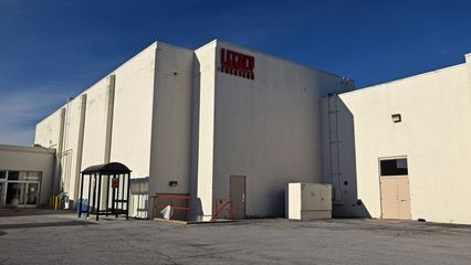 Movie theater building, with signage for Legacy Theaters, which was the final operator of the movie theater.