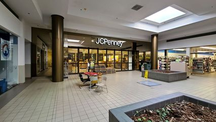 JCPenney had closed in October 2014, so that space was not accessible to me during my final visit. However, it appeared that the space was being used for storage by Know Knew Books.