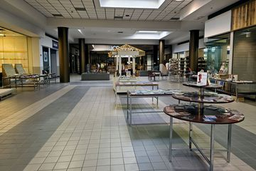 With JCPenney gone, the last 100 feet or so of the JCPenney wing was being used as part of Know Knew Books, partitioned off from the rest of the mall with shelving.