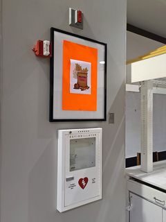 Automated external defibrillator station in the mall's center court. The defibrillator itself is missing.