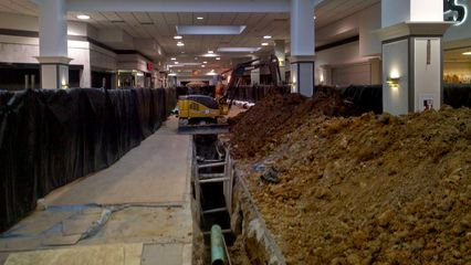 In January 2010, the floor in the center court, as well as part of the corridor between the center court and the former Montgomery Ward store, was dug up in order to replace a sewer line. When the work was complete, the original appearance, cheap wood-look flooring and all, was restored.