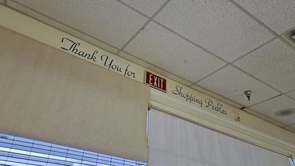 """""""Thank you for shopping Peebles"""" sign over the mall entrance at Peebles."""