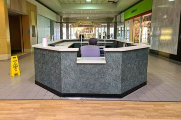 Customer service and security desk in the center corridor.