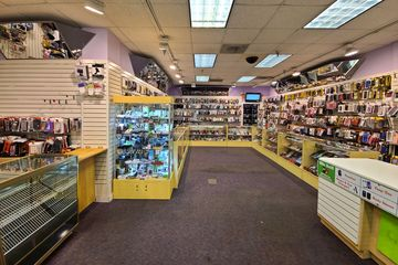 Interior of Cell Express, located in the old Claire's space. The store still looks like Claire's inside.