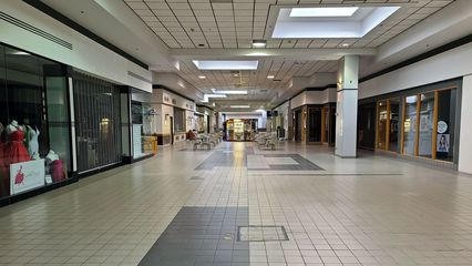 Main mall corridor between Peebles and Montgomery Ward, facing north. The center court is immediately behind the camera.