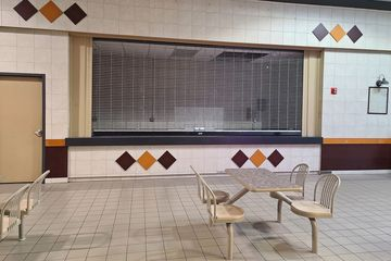 A former pretzel place in the food court. Prior to being built out as a pretzel place, it housed a coffee shop called the Chippery.