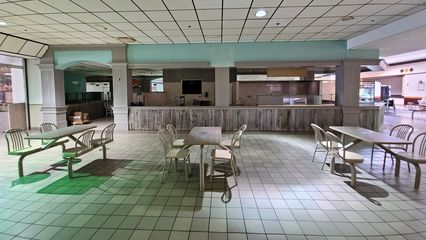 Former Angelo's Pizza (later Laconi's Pizzeria) space in the food court. This was the only restaurant in the food court to have its own seating area, separate from the seating in the mall itself.