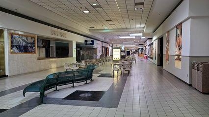 Food court seating in the main corridor, in front of Hot Wok, Angelo's, and Church United. As you can see, it was a very small food court - much smaller than the original food court - located directly in the main mall corridor.