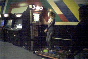 A photo from February 20, 2006 showing Jessica Lynn Siple playing Dance Dance Revolution at Video Zone.