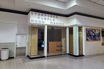 """Returning to the main corridor, next to Hot Wok was the former GNC space. The final tenant in this space was a store called Starfire's Purple Moon Magick, which is """"a professional metaphysical store who regards metaphysics as a spiritual philosophy or way of life."""" As Starfire's, the store looked like this when it was open. In any case, it still bore a strong resemblance to the tenant that it was built out for, i.e. GNC."""