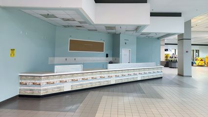 The former home of Big Dipper, an ice cream shop in Staunton Mall that sold Hershey's ice cream. After Big Dipper closed here, the space was redecorated for another ice cream shop called Flavor Cravers, which itself had closed by 2014. The space appears here as it did when it housed a second location for Stuarts Draft-based Sooner BBQ, which operated here from 2017 to 2019.