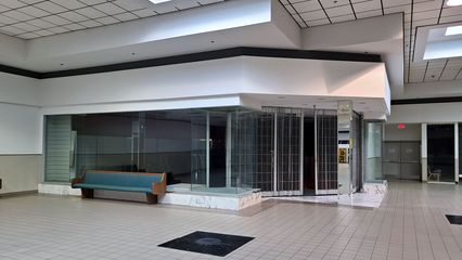 Former Hofheimer's shoe store. Hofheimer's closed here in the mid 1990s, and housed a number of independent stores in the following years, most notably another shoe store named Bootleggers, as well as the final mall location of E's Trading Post.