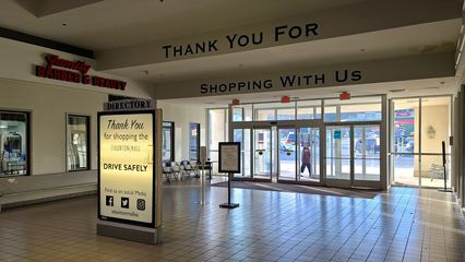 """Mall entrance next to Family Barber & Beauty. Like at the other mall entrance, the """"Thank You For Shopping With Us"""" text dates from the Colonial Properties era."""