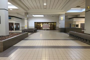 Court in the Belk wing, between the entrance to Montgomery Ward and the mall entrance.