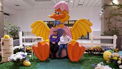 The Belk wing court was also where the mall would have its Santa Claus and Easter Bunny setups. Here, Elyse and I smile for the camera in an Easter display on March 30, 2016, after the Easter Bunny had already gone home for the day. The entrance to Montgomery Ward is behind us.
