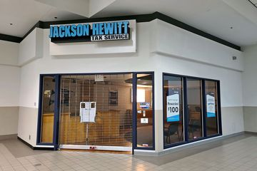 Jackson Hewitt Tax Service office, immediately to the left of the Wards entrance. Jackson Hewitt occupied a space that was built out in the late 1990s for a CFW Intelos (later nTelos) store.