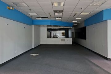 Next to Jackson Hewitt was this space that originally housed Richard Bartley Optical, which later became Pearle Vision.