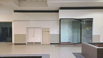 These two store spaces have been walled off for as long as I can remember. It is possible that these spaces were never leased throughout the mall's entire history, according to a longtime mall tenant that I corresponded with online.