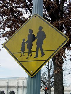 """Near Union Station, this sign puts a new twist on the traditional """"PED XING"""" sign, showing a family crossing the street."""