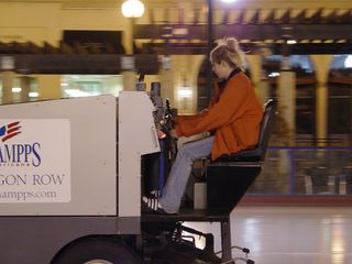 Rheannin, one of the employees at the Pentagon Row ice rink, resurfaces the ice by taking the Zamboni out for a spin.