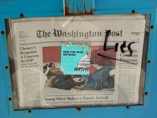 """This Washington Post box has a sticker about the September 24 protest on its face, as well as """"Lies"""" written in marker nearby."""