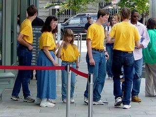 """Meanwhile, outside the International Spy Museum, we found a group exemplifying Washington DC in spring: matching shirts. It's either matching shirts, or kids wearing ID badges. Or a whole bunch of people wearing """"FBI"""" or """"CIA"""" shirts. Either way, these groups are normally not exactly well-behaved..."""