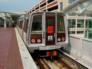 After checking out Code Pink, I went railfanning, which was the main reason for taking the trip on July 4, since Metro runs a special service pattern on that day. Note that this Rohr at Largo Town Center is signed as an Orange Line train. Also note the weather. Perfect, clear skies.